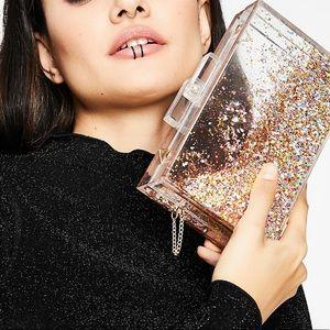 Skinny deep lucite clear pink liquid glitter bag